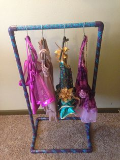 Portable personal costume rack I made for my daughter.  View this and more on my Facebook page: www.facebook.com/LetsPaintByKelly