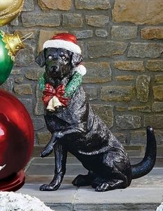 Wearing an illuminated wreath and a festive Santa hat, this handsome Labrador retriever barks, wags his tail and plays Christmas songs whenever people pass by. A built-in motion sensor activates the music, flashing LED lights and animation that make this a must-have addition to your holiday decor.