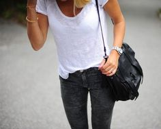 Classic white deep v-neck tee with skinny dark jeans, watch, simple gold bangle, and a black shoulder bag. Simple and chic.