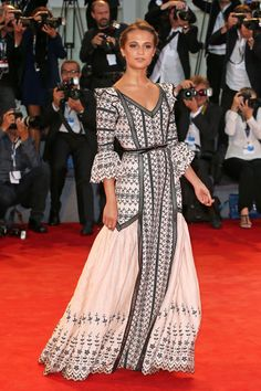 Alicia Vikander in Louis Vuitton at the 2015 Venice Film Festival. See all the stars' gowns, dresses, and jewels from the premieres.