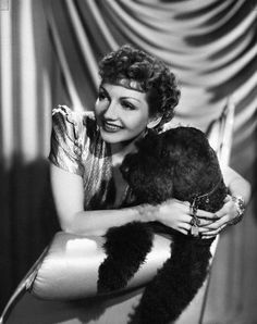 0 Claudette Colbert and black dog in her arms