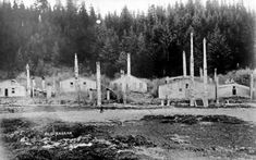 Man standing in front of dwellings and totem poles, Old Kasaan, Alaska, circa 1910 La Rive, Totem Poles, Man Standing, Indigenous Art, Pacific Northwest, British Columbia, Art Forms, Raven, Alaska