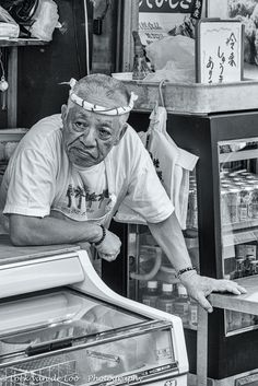 Portrait of Japan - Salesman on the fish market Tjuliji in Tokyo looking to the people passing by.