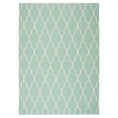 Add a pop of pattern to your living room or den with this artfully crafted rug, showcasing a trellis motif in aqua.      Product: