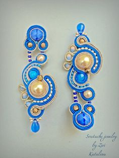 Cobalt blue statement soutache earring, beaded gold pearl earring, bridesmaid jewelry, soutache earring, soutache jewelry, blue gold earring  soutache cobalt blue golden earrings model Katalina  Approximate size: 7 cm long, 2.5 cm wide.. ( long 2.3 in., wide 0.63 in. ) Middleweight Materials used: Czech glass faceted, Czech pebbles, Soutache braid, Swarovski crystal pearls beads, glass beads, Czech glass tears, hook clip screw type, synthetic suede to the rear Colored earrings: cobalt blue…