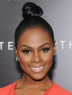 Wearing the go-to hairstyle of Summer, the topknot, Tika Sumpter | See Our Top 10 Celebrity Looks of the Week! | POPSUGAR Beauty