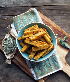 Baking polenta chips are not only healthier for you but give a better result. These polenta chips are made with ricotta and rosemary with a sage salt.