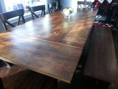 Reclaimed wood dining table with end leaves