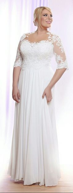 Plus size wedding gown with illusion neck line and lace sleeves. Taria. Studio Levana