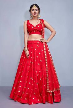 Give yourself an unique look by wearing this exquisite red taffeta silk lehenga choli. This spectacular attire is highlighted interestingly mirror work that gives a divine look to the outfit. Party Wear Lehenga, Indian Lehenga, Silk Lehenga, Bridal Lehenga, Anarkali, Plain Lehenga, Wedding Lehanga, Salwar Designs, Lehenga Designs