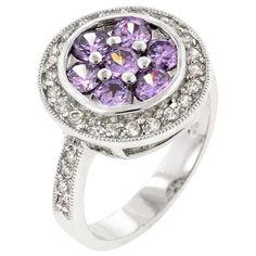 White Gold Rhodium Bonded Fashion Ring with Amethyst CZ Center and Clear CZ Outer Layer in Silvertone. Hidden Bloom's delicate look displays seven amethyst cubic zirconia and an additional layer of clear accents. White Gold Rhodium Bond is achieved using an electroplating process that coats the item with heavy layers of rhodium a close cousin of platinum that costs three times as much which gives our jewelry a platinum luster.