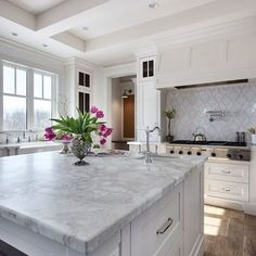 We all love a good white kitchen but in reality I love all of the little details that you can show off in this type of setting.  I have a client who is remodeli
