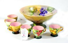 Handpainted pedestal punch bowl set with six cups