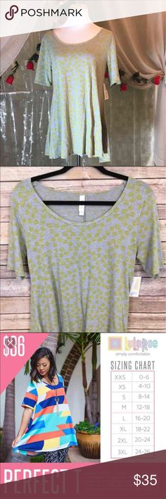 LULAROE PERFECT T gray and yellow NWTs LLR PERFECT T size XS brand new with tags. Is gray with faded yellow polka dots throughout. Would also likely fit XXS, S , M, L depending how you like it to fit. So many ways to wear!! Would go great with jeans or would match many different LuLaRoe leggings! I paid $39 for this. LuLaRoe Tops Tunics