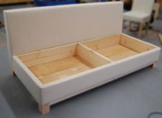DIY Furniture Plan from Ana- A sofa that you can build with a fold out seat perfect for storing extra pillows and blankets. Based off a sleeping pad foam cushion, so seating surface doubles as a guest bed. Diy Furniture Plans, Furniture Projects, Furniture Making, Home Projects, Home Furniture, Furniture Stores, Luxury Furniture, Furniture Chairs, Furniture Online