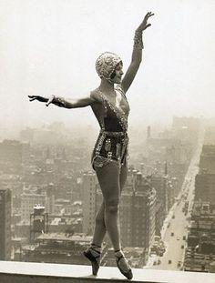 1920s ballerina atop a high building.