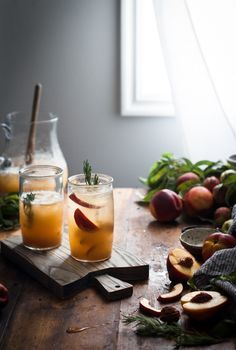 Fresh Nectarines and honey combine to make a syrup, infused with rosemary, in this sparkling, summery take on a shrub.