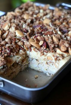 Praline Crunch Apple Cake...a super moist apple cake topped with brown sugar icing and a Praline Crunch that's buttery and delicious!