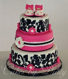 tiered cake,  black and pink