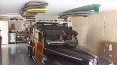 a retro garage with ceiling storage for retro surfboards