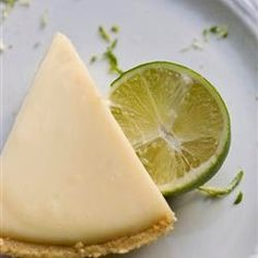 Key Lime Pie   This recipe uses condensed milk and sour cream. Fabulously easy. . . a summertime favorite! If you have time, a homemade graham cracker crust is better! Garnish with whipped cream and thin slices of lime if you like.