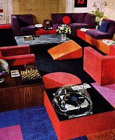 1960s interior...is that a hunk of cheddar cheese in the center of the room? what is going on here?