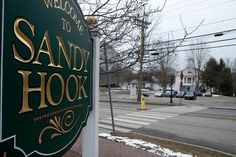 A sign leading in to the Sandy Hook neighborhood in Newtown, Conn. (Photo: Getty Images)