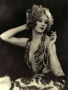 "Faith Bacon, burlesque dancer and actress, billed as ""America's Most Beautiful Dancer"", performer, Ziegfeld Follies 1931 open dress in 1931!"