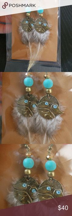 Two birds on a branch metal earrings from Mexico These cute little earrings are hand made by Mexican artisans in the state of Jalisco.   #mexican  #artisan  #handmade  #metal  #painted  #seeds  #feathers   ***Note: there may be slight differences on each earing due to it being handmade*** Jewelry Earrings