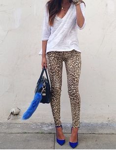 Love the cobalt shoes and leopard leggings with the simple white shirt, hate the purse.