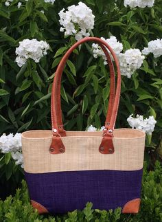 Raffia Lova Handbag with zip fastening is chic for business or pleasure