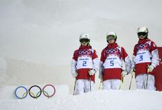Dufour-Lapointe sisters - (L-R) Canadian sisters Justine Dufour-Lapointe, Maxime Dufour-Lapointe and Chloe Dufour-Lapointe wait for the start ...