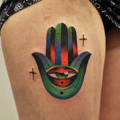Lily Hand Eye Tattoo