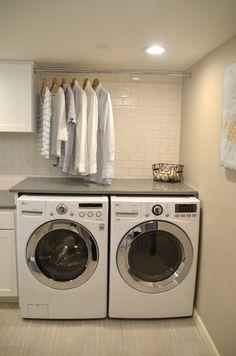 Neat Little Nest: Organized Laundry Room. #Organized #White #SubwayTile # Hanging