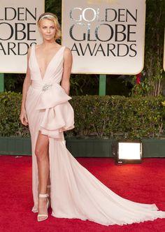 Dress and bag - Dior; Jewelry - Cartier; Shoes - Gibenchy;
