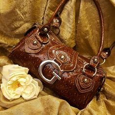 ONE DAY SALE GUESS  leather chestnut brown as new leather. With luxe details like polished hardware, this must-have features both style and substance Guess Bags