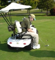 This golf car has a swivel seat for either side of the golf cart. The individual is strapped into the seat to prevent falling forward when leaning to golf. The cart is adapted so that individuals with mobility impairments can still enjoy golfing.