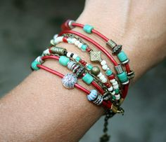 This fun bracelet is made with Metallic Moraccan Red leather cord, a wide assortment of colorful beads and antique brass chain and closures. Check out my Etsy site! http://etsy.me/VEKbts