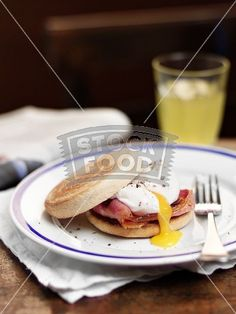 English muffin with bacon and a poached egg