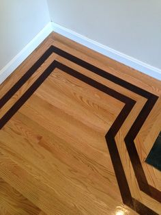 Wood Brick Inlay Floors For The Entryway Leading Into