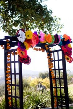 wedding-ceremony-gazebo-decorated-with-paper-flowers-mexican-theme-wedding
