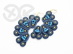 Soutache Earrings  Description: Soutache earrings, made with soutache and glass, finished with navy blue felt, metal (gold colored) earwires. Width about 3 cm, length about 7 cm. Crafted in a sole copy, meant to be a unique piece. Handwash in gentle detergents at low temperature (up to