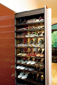 """Interesting larder-style pull-out cabinet makes shoes """"disappear"""" into the wall!"""