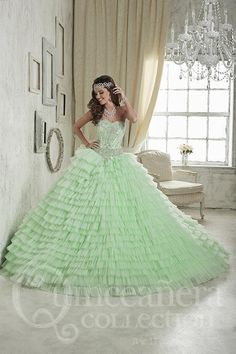 A dazzling gown with an immaculately-beaded bodice complementing a dipping Basque waistline and sweetheart neckline. The skirt is comprised of numerous layers of color-rich organza. Download the Quinc