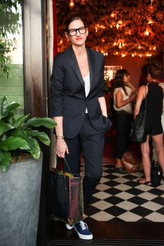 Jenna Lyons in a suit and sneakers, making for an elegant yet laidback look.