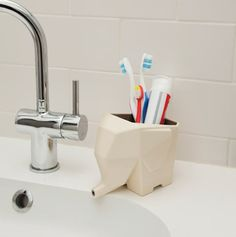 An elephant to hold your toothpaste and toothbrush. | 32 Insanely Awesome And Inexpensive Things You Need For Your Bathroom