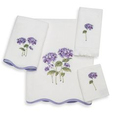 "Avanti Garden Bloom Bath Towels, 100% Cotton    The embroidered hydrangea flowers on these pure white towels add a nice bit of color to your bathroom. The scalloped edge trimmed in purple is the perfect finishing touch. 100% cotton. Fingertip measures 11"" x 18""; washcloth 13"" x 13""; hand towel 16"" x 30""; bath towel 27"" x 50"". Machine wash but dry cleaning recommended. Made in Canada and embellished in the USA of imported materials"