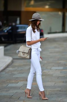 All white. White jeans, white shirt, nude pumps
