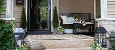 Outfit your porch with comfortable and functional decor with an elegant yet understated aesthetic. Topiaries and lanterns are reminiscent of French courtyards and add old-world charm. Maintain a casual feel with bench seating, plenty of pillows, and an outdoor rug.