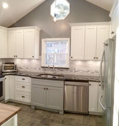 Photo gallery of remodeled kitchen features CliqStudios Dayton Painted Harbor cabinets